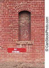 No Parking - Brick wall with no parking and peace signs