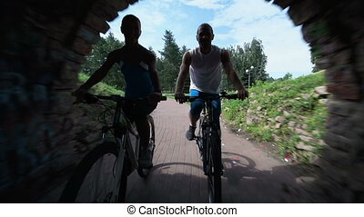 Recreational Cycling - Two cyclists passing by beautiful...