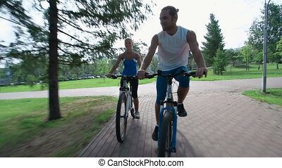 Try and Catch Me - Guys having fun on their bicycle ride
