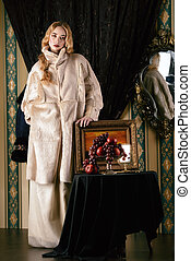 white coat - Fashion shot of a beautiful lady in a luxurious...