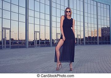 Woman in long black dress