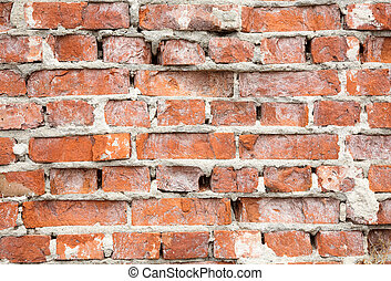 Destroyed wall from a red brick background - Surface of the...