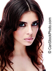 Closeup portrait of a beautiful woman with long brown hair