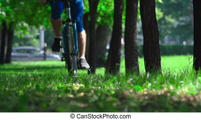 Cycling Walk - Slow motion of cropped cyclist approaching...