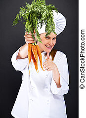 female cook in white uniform with bunch of carrots thumb up