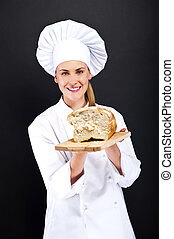 Chef baker smailing, fresh baked bread.