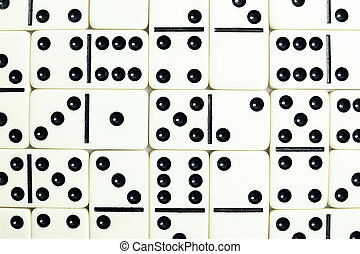 Wall from grey bones of dominoes background