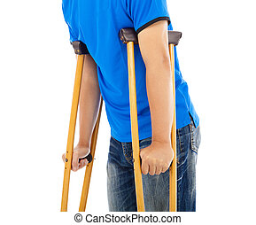 close up of young man on crutches white background