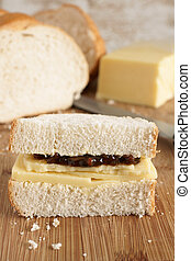 Cheese and pickle sandwich - Hand cut Cheddar cheese and...