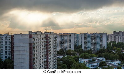 Timelapse of clouds over city houses