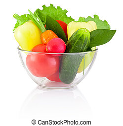 Fresh vegetable in transparent bowl isolated on white background