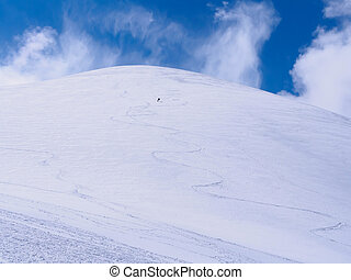 Skier at the mountains - Lone skier at mountain winter snow...