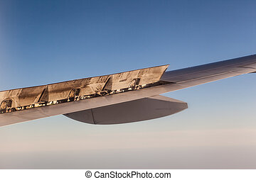 Flaps - detail of the wing of a commercial airplane during...