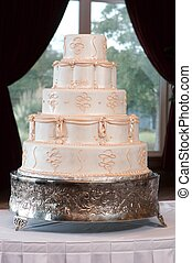 Decorative wedding cake - Image of a wedding cake framed by...
