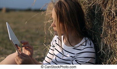 Young woman with touch pad in the countryside - Dolly shot...