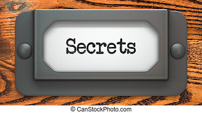 Secrets Concept on Label Holder - Secrets Inscription on...