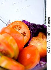 blending vegetables - vegetables being prepared in the...