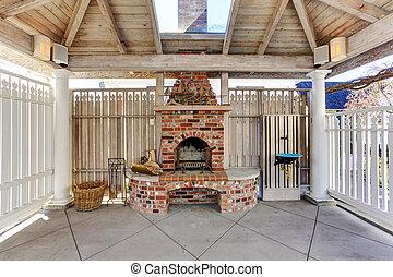 Pergola with brick fireplace on backyard