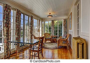 Bright sunroom with wicker furniture - Bright sunroom with...