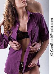 Man undressing woman from purple shirt