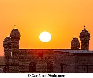 mosque silhouette at dawn sun