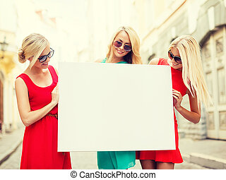 three happy blonde women with blank white board - summer...