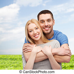 smiling couple hugging - love and family concept - smiling...