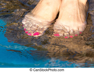 pedicure on foot in the water on the rocks