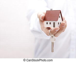 House key in hand - House key in hand