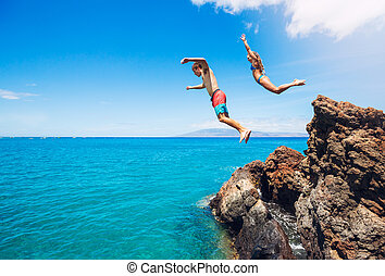 Cliff jumping - Friends cliff jumping into the ocean, summer...
