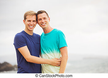 Gay couple on the beach - Happy loving gay couple on the...