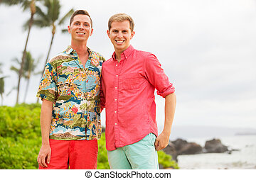Happy gay couple - Young happy gay couple on the beach