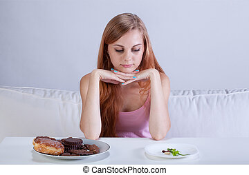 Skinny girl can't eat sweets - View of skinny girl can't eat...