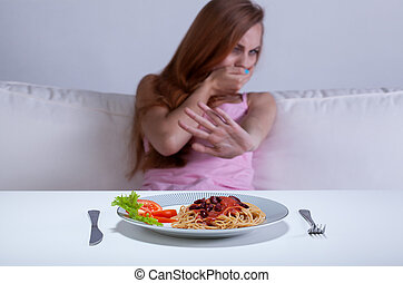 Dieting girl can't eat dinner - View of dieting girl can't...