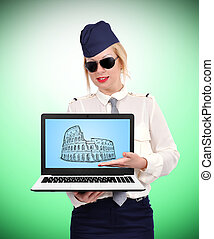 laptop with coliseum - stewardess holding laptop with...