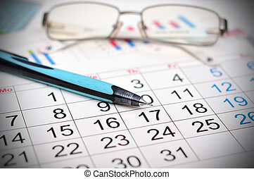 calendar - Workplace with calendar, pen and glasses work...