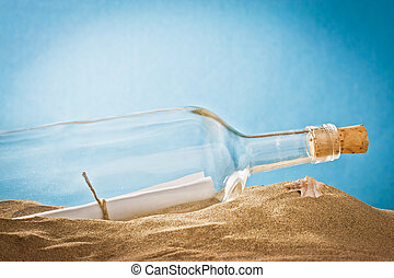 message in bottle on sand - glass bottle with message on...