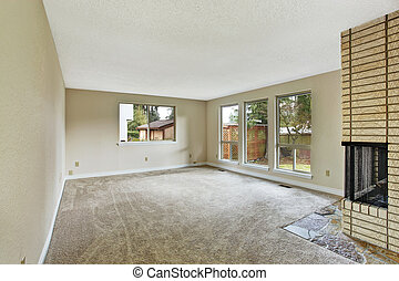 Empty bright living room with fireplace