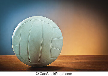 volleyball ball on wood with colored background