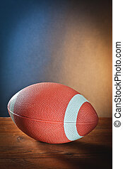 rugby ball on wood with colored background