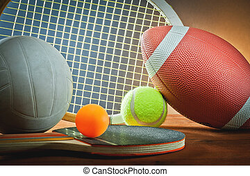 Assorted sports equipment.Tennis,rugby,volleyball and...