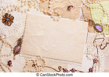 old paper sheets surrounded by retro womens accessories