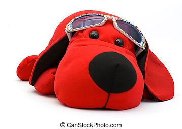 red toy dog in sunglasses