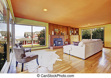 Bright living room with glass wall and fireplace