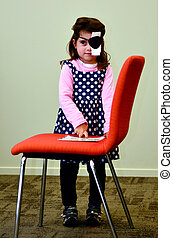 Vision check for pre-school children - Pre-school child Girl...
