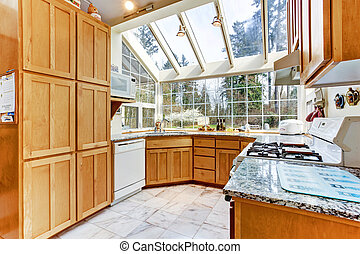 Bright kitchen room with glass wall and ceiling