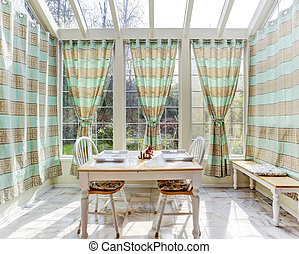 Bright sun room with dining table set - Bright sun room with...