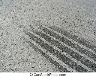 braking marks of a car tire on a grey asphalt road