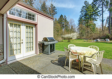 Backyard patio area with barbecue