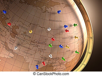 Travel Route - Antique globe with nails marking the travel...